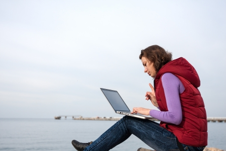 Woman working on the laptop outdoor Stock Photo - 17544090