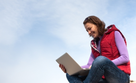 Young woman working with her laptop