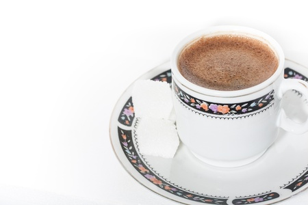 A cup of coffee with froth on white background  Stock Photo