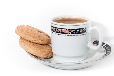A cup of turkish coffe with froth and cookies isolated on white