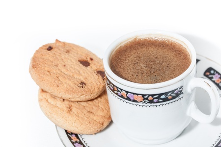 A cup of turkish coffe with froth and some cookies isolated on white Stock Photo