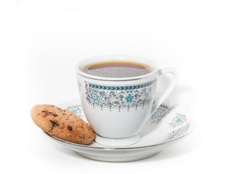 A cup of coffee with cookies on white background