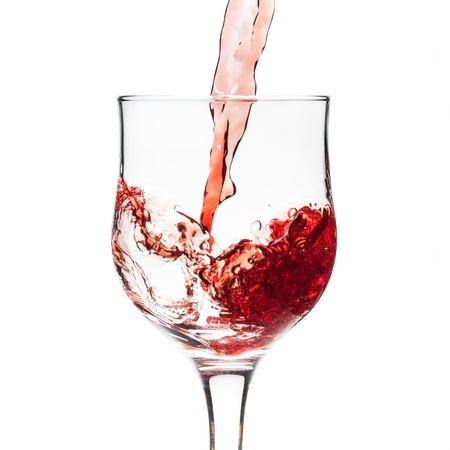 red wine being poured into glas Stock Photo