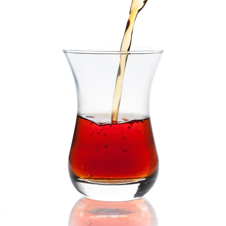 Pouring a cup of hot turkish tea