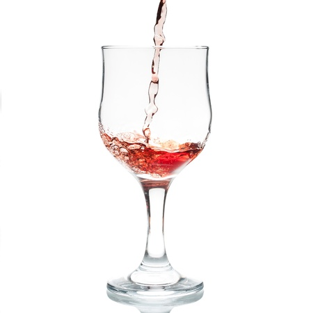 red wine being poured into glas photo