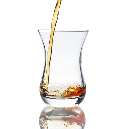 Glass of hot black Turkish tea isolated on white background