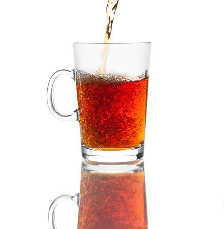 Glass of hot black tea isolated on white background Stock Photo
