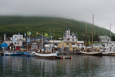 Icelandic Seaport: Boats for fishing and for whale watching tours gather at the port of Husavik, Iceland. Stock Photo