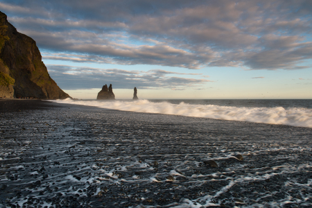 Sea Stacks and Basalt Clifs to the East of Reynisfjara Black Sand Beach, near Vik in Southern Iceland Фото со стока
