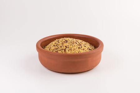 bowl of raw bulgur and quinoa isolated on white background
