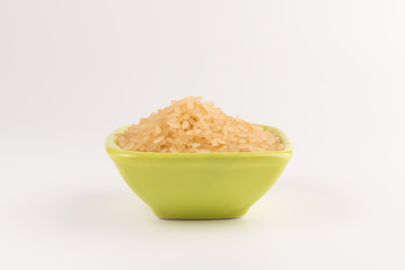 white rice in bowl isolated on white background Standard-Bild