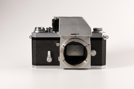 An old film camera is isolated on a white background