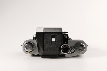 An old camera is isolated on a white background