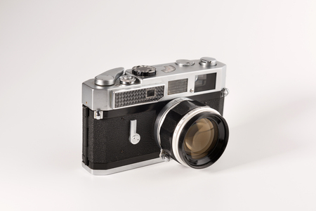 An old rangefinder camera is isolated on a white background Reklamní fotografie