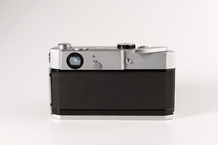Old photo camera isolated on white background, back view
