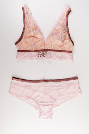 pink lace tender lingerie set isolated on a white background, top view