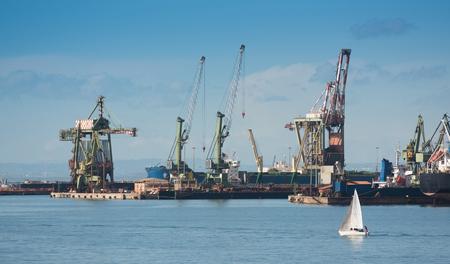 Industrial shipping cranes in the port of Taranto, Italy, Puglia