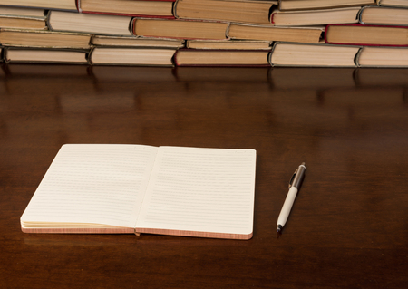 notebook and pen on the wooden table