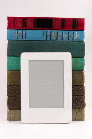Electronic book with stack of regular old books