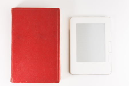 Digital e-book reader with a blank screen with old paper book isolated on white background 写真素材