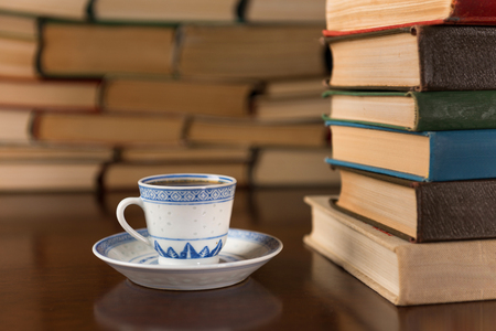 cup of coffee on the background of books