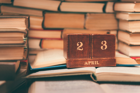 wooden calendar on the background of books, world book day