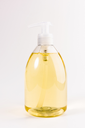 yellow liquid soap  isolated on a white background Archivio Fotografico