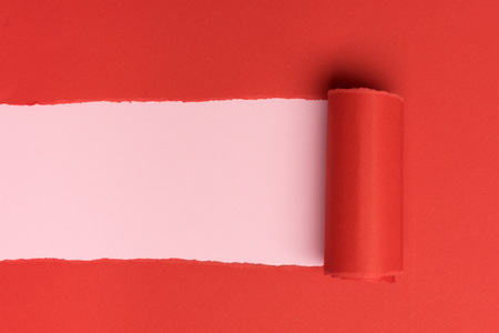 Red torned paper over pink background