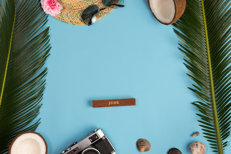 Creative Flat lay fashion style with camera, sunglasses and panama hat on blue pastel color background 版權商用圖片