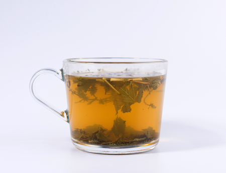 green herbal tea in a transparent cup isolated on white background 免版税图像