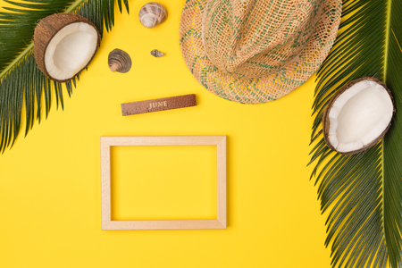 summer photo frame on yellow background, top view