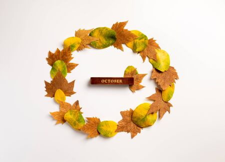 Autumn composition. Wreath made of maple leaves on white background. Autumn, fall, thanksgiving day concept. Flat lay, top view, copy space