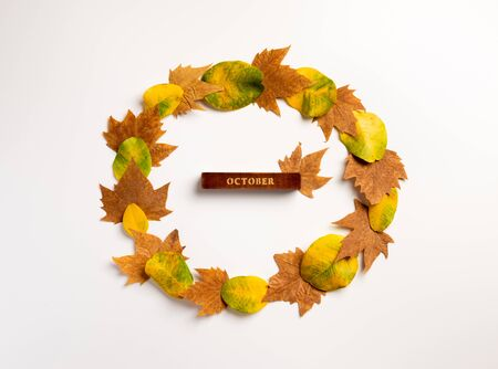 Autumn composition. Wreath made of yellow leaves on gray background. Autumn, fall, thanksgiving day concept. Flat lay, top view, copy space