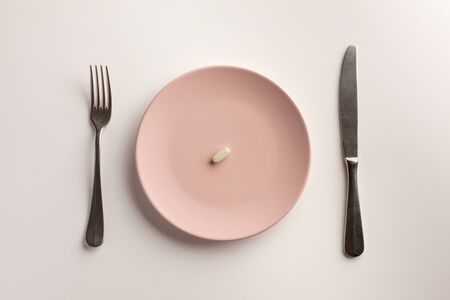 Pill on a plate. Flat lay.
