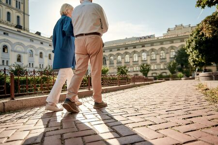 Traveling. Elderly stylish couple walking together outdoors. Family. Love concept