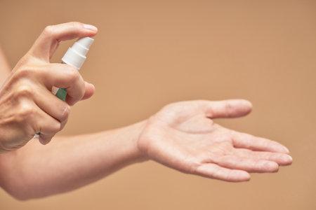 Woman is using antibacterial hand sanitizer gel
