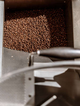 Coffee beans in metal container of coffee roasting machine Banque d'images