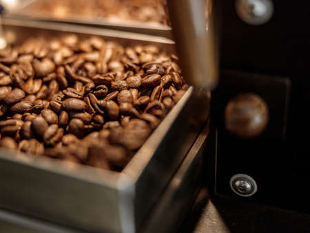 Industrial coffee roasting machine with roasted coffee beans