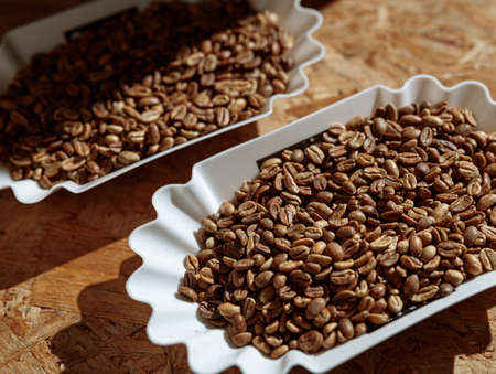 Bowls of roasted coffee beans on table