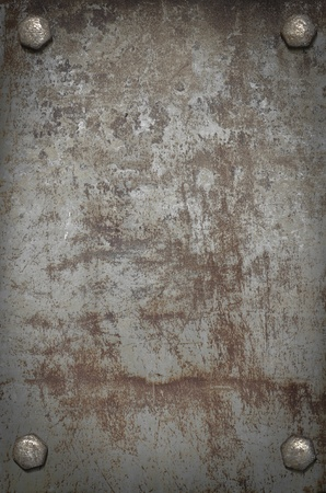 scratched: grunge background  metal plate with screws Stock Photo