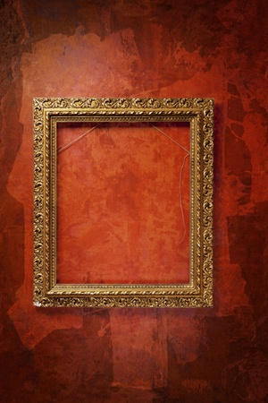 gold textured background: old frame on the red wall