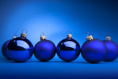Photo of blue Christmas balls on a blue background photo