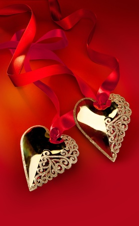 Christmas decoration Golden Heart with red ribbon photo