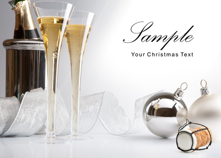 Christmas card with Christmas tree balls and glasses of champagne on a white background Banco de Imagens