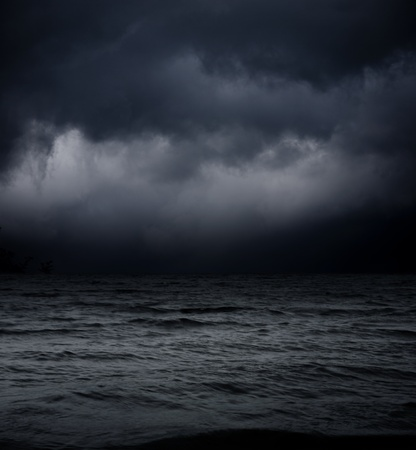 wind storm: abstract dark background. sea waves against the black sky