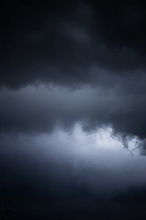 danger of an impending storm, a dark stormy sky photo