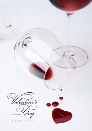 wineglasses: Two glasses and spilled wine