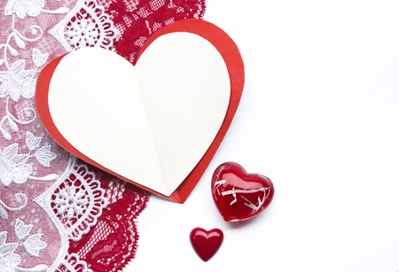 Greeting card in the shape of hearts and red roses on a white background photo
