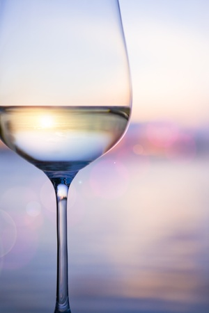 white wine glass: white wine on the sky background with clouds Stock Photo