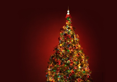 Art Christmas tree on red background Stock Photo - 10578183